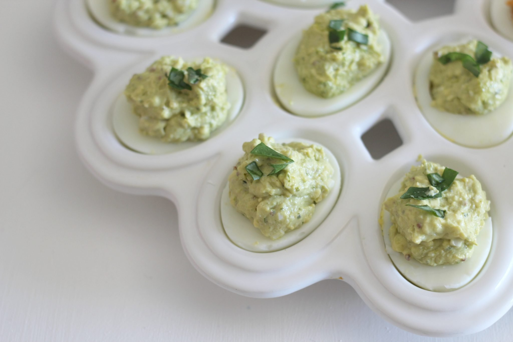 Garlic Pesto Deviled Eggs. These low carb appetizers are delicious and the recipe is simple!