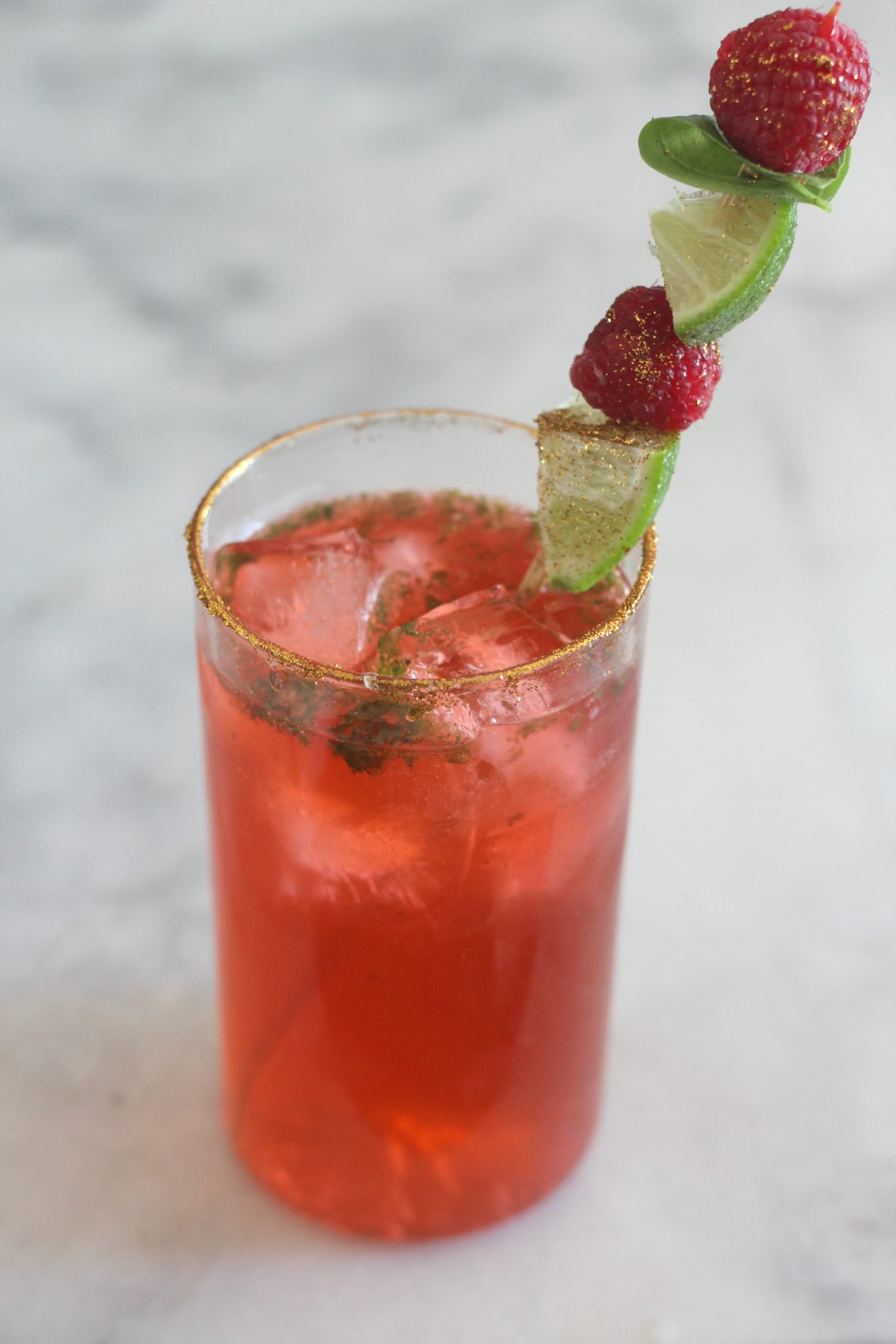 This Raspberry Basil Sparking Cocktail is just the brunch cocktail of your dreams. Made with Torani Sugar Free Syrup and fresh lime and basil, it is light and fruity and contains zero carbs! #AToraniBrunch