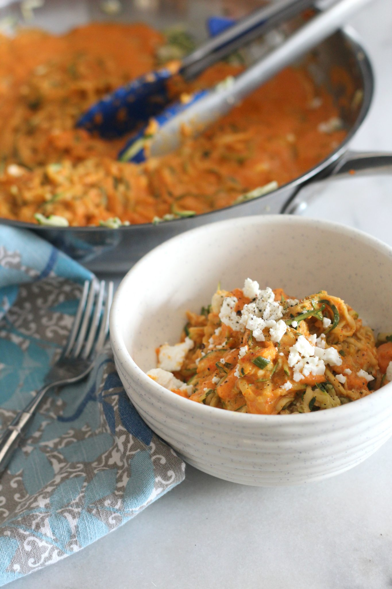 This recipe for zucchini noodles with roasted bell pepper and feta sauce is such a healthy and tasty dinner. Add some chicken to make it a meal or serve it as a low carb side dish.
