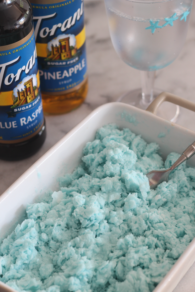 This sugar free blue mermaid vodka granita is perfect way to celebrate summer. Made with Torani Sugar Free Syrups, coconut milk and vodka, you can enjoy fun cocktails while staying low carb! #AToraniVacation #ad