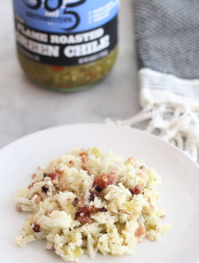 Add a little heat to your dinner with this green chile and bacon cauliflower rice! Creamy and spicy, this keto side dish is delicious. #lowcarbdelish #ketosidedish #cauliflowerrice #bacon #lowcarbrecipes #ketorecipes #greenchile