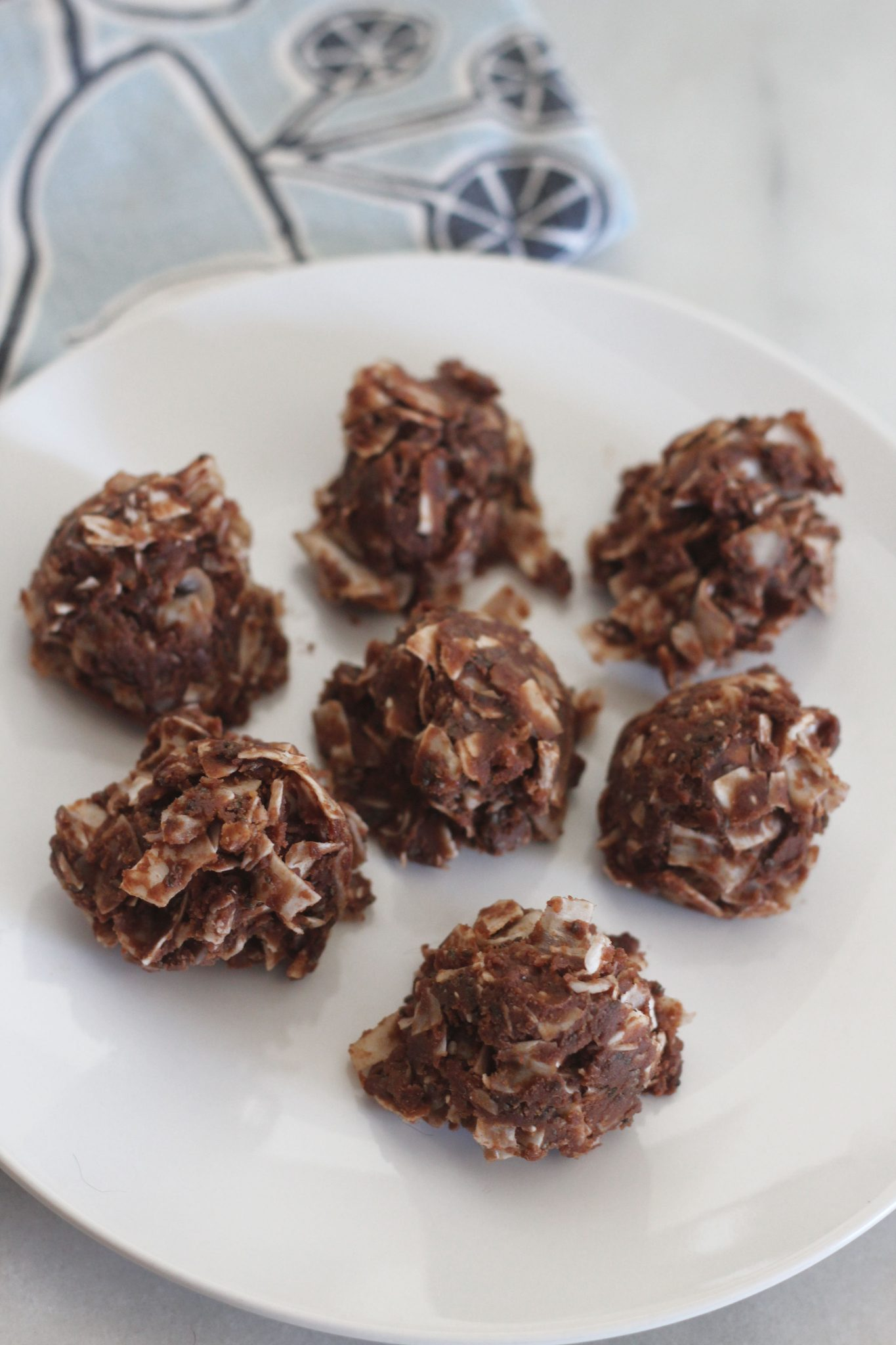Chocolate coconut frozen nut butter bites! These delicious little fat bombs are perfect to keep in the freezer for those moments that you need a sweet snack. #lowcarbdelish #ketodesserts #fatbombs #chocolatepeanutbutterbites #lowcarbdesserts #ketorecipes