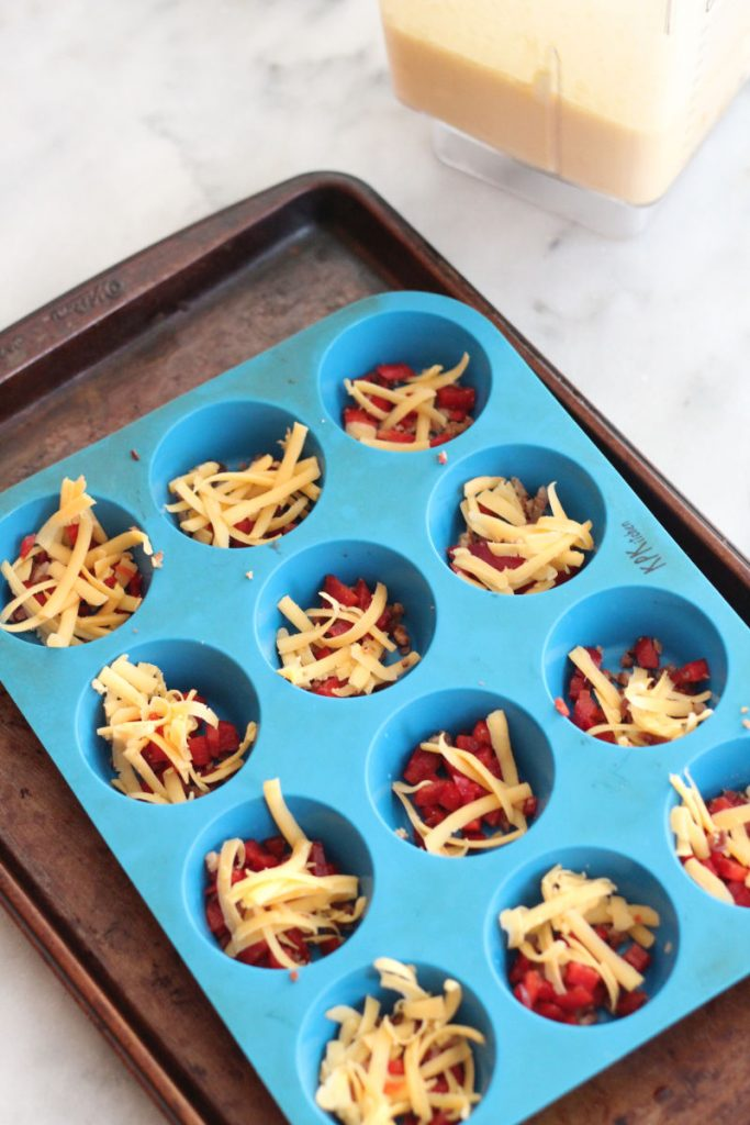 These keto bacon, bell pepper and cheddar eggs bites are great for breakfast or a post workout snack. Only one carb per egg bite!