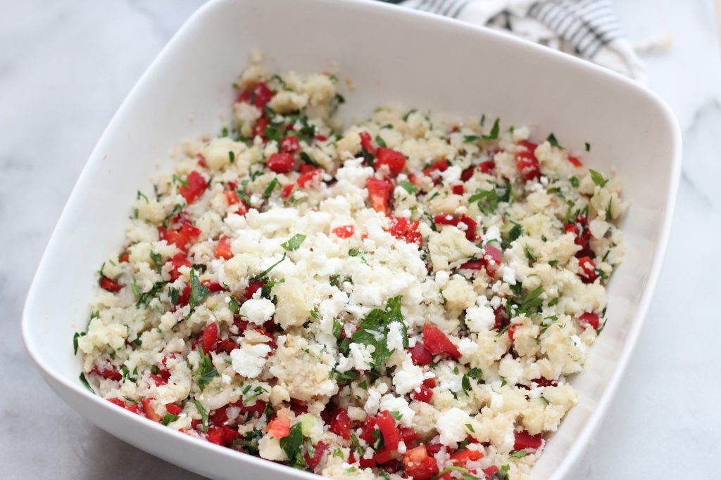 keto cauliflower rice salad with red bell peppers and parsley and feta cheese