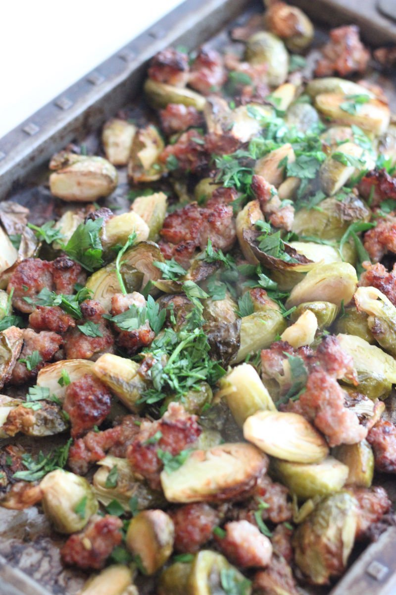 Roasted Brussels sprouts and sausage is a great keto side dish or meal. It is easy to make on a sheet pan and great for a weeknight dinner. #lowcarbdelish #ketodinner #ketorecipes #ketosidedish #lowcarbsidedish