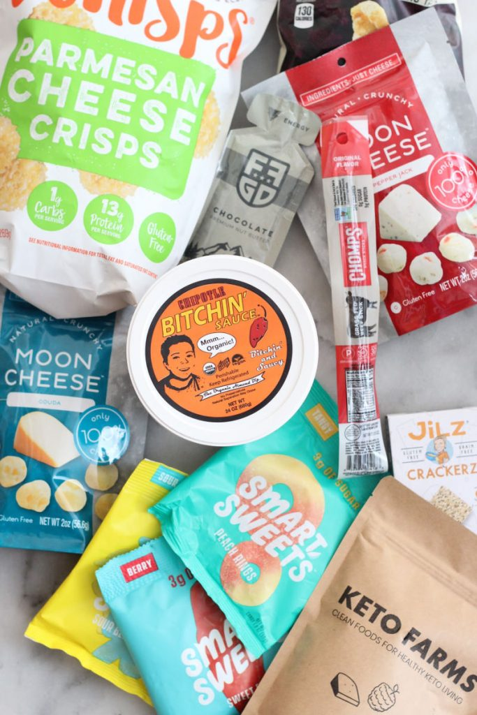 Best tasting keto snacks including whisps, moon cheese, chomps sticks, bitchin' sauce, smart sweets gummies. #lowcarbdelish #keto