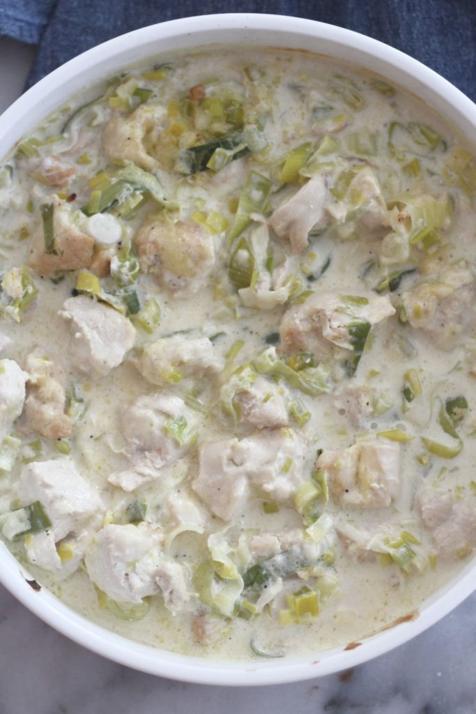 This low carb / keto creamy leek and chicken recipe is just amazing There is something about the leeks that add so much flavor, along with the garlic, chicken broth and white cheddar. The cream cheese makes this so creamy. Honestly, this dish is being added to our weekly dinner rotation. It's that good. #lowcarbdelish #ketochicken #ketorecipes #chickendinner